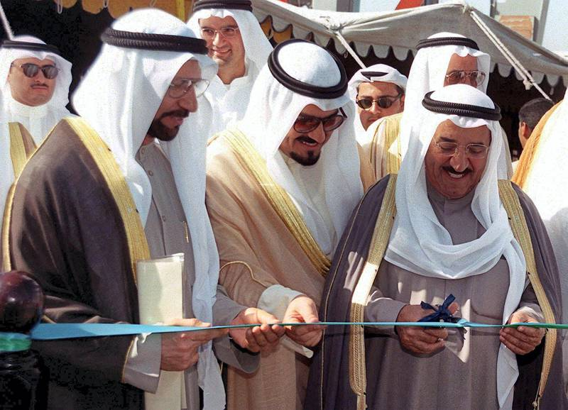 Kuwait's Foreign Minister Sheikh Sabah al-Ahmad al-Sabah (R), Commerce Minister Abdel Wahab al-Wazzan (L) and Finance and Communications Minister Sheikh Ahmad al-Abdallah al-Sabah (C) open the Gulf emirate's free trade zone 22 November 1999. The zone occupies 10 000 square meters of land, more than 60 contracts have already been signed with local and international investors taking up 70 percent of the available spaces. (Photo by RAED QUTENA / AFP)