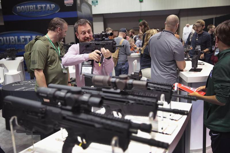INDIANAPOLIS, INDIANA - APRIL 27: Guests shop for firearms and accessories at the 148th NRA Annual Meetings & Exhibits on April 27, 2019 in Indianapolis, Indiana. The convention, which runs through Sunday, features more than 800 exhibitors and is expected to draw 80,000 guests.   Scott Olson/Getty Images/AFP (Photo by SCOTT OLSON / GETTY IMAGES NORTH AMERICA / Getty Images via AFP)