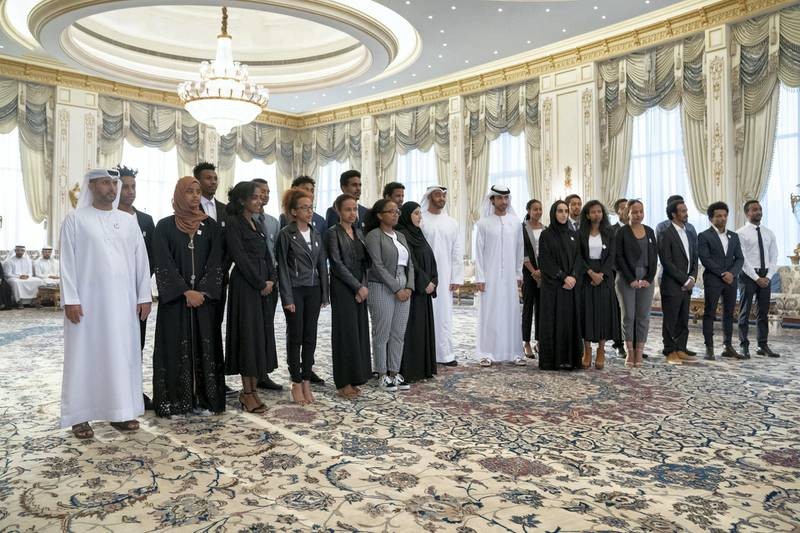 ABU DHABI, UNITED ARAB EMIRATES - October 28, 2019: HH Sheikh Mohamed bin Zayed Al Nahyan, Crown Prince of Abu Dhabi and Deputy Supreme Commander of the UAE Armed Forces (C), stand for a photograph with scholarship students from Eritrea and Ethiopia, who are studying in the UAE, during a Sea Palace barza.  ( Hamad Al Kaabi  / Ministry of Presidential Affairs ) ---
