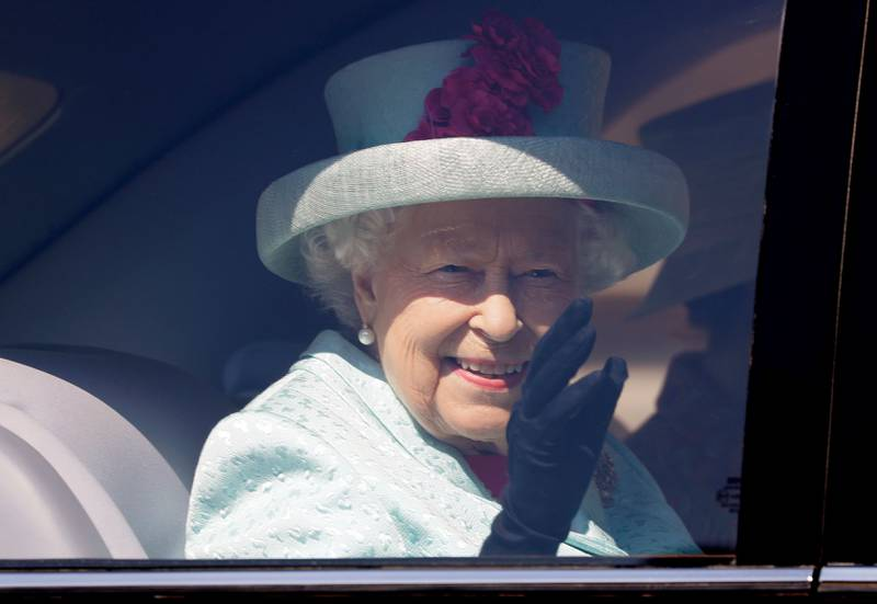 (FILES) In this file photo taken on April 21, 2019, Britain's Queen Elizabeth II waves from her car after attending the Easter Mattins Service at St. George's Chapel, Windsor Castle. Queen Elizabeth II will retire to Windsor Castle a week early and a state visit by the emperor and empress of Japan is being reviewed due to coronavirus, Buckingham Palace said Tuesday, March 17. The 93-year-old monarch has already postponed some public engagements, and further changes are now being made to her diary in the wake of stricter measures introduced by the British government.  / AFP / POOL / KIRSTY WIGGLESWORTH
