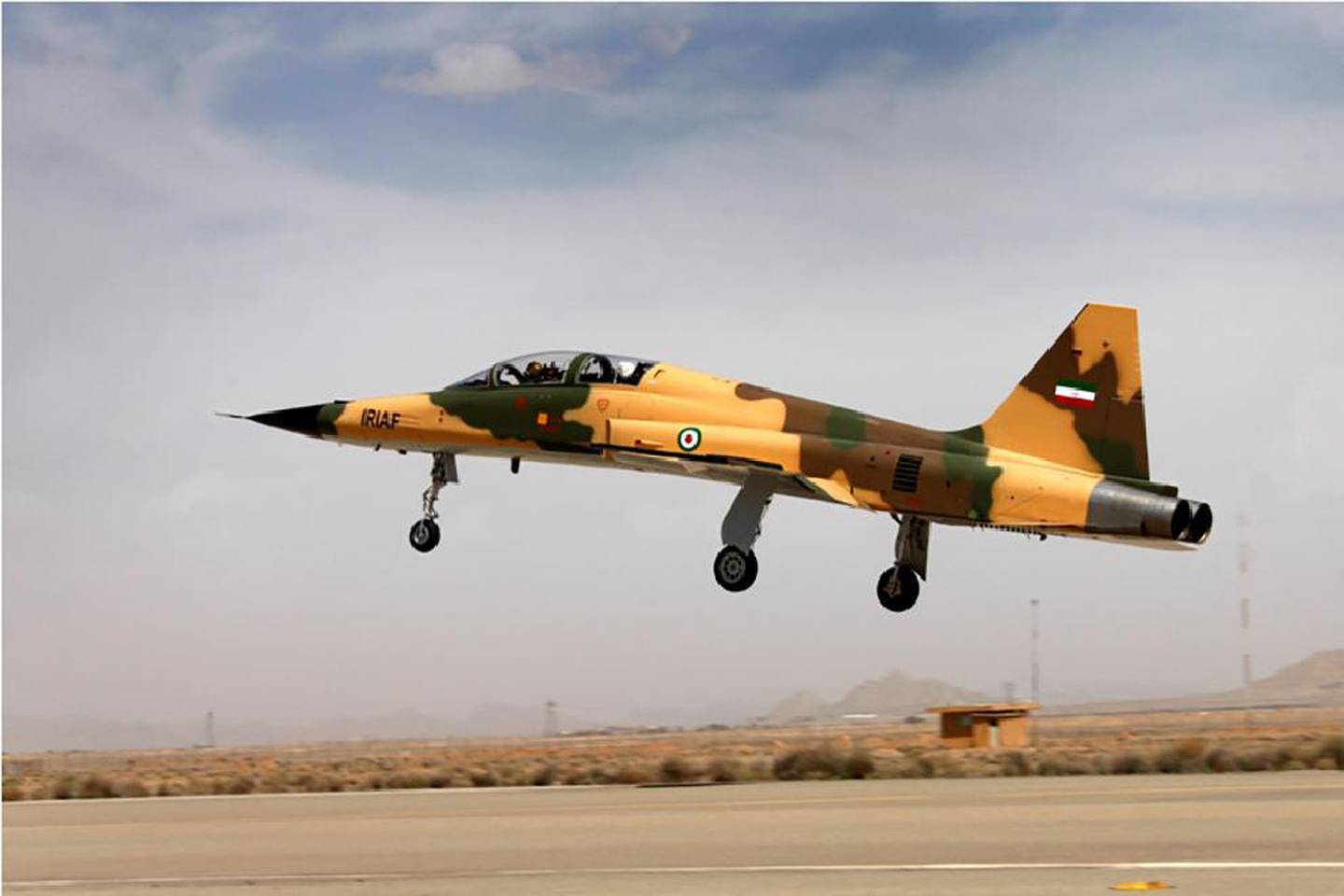 """A handout picture released by Iran's Defence Ministry on August 21, 2018, shows the  """"Kowsar"""" domestic fighter jet, a fourth-generation fighter, with """"advanced avionics"""" and multi-purpose radar, which the local Tasnim news agency said was """"100-percent indigenously made"""". - Iran unveiled its first domestic fighter jet at a defence show in the capital Tehran today. (Photo by HO / IRANIAN DEFENCE MINISTRY / AFP)"""