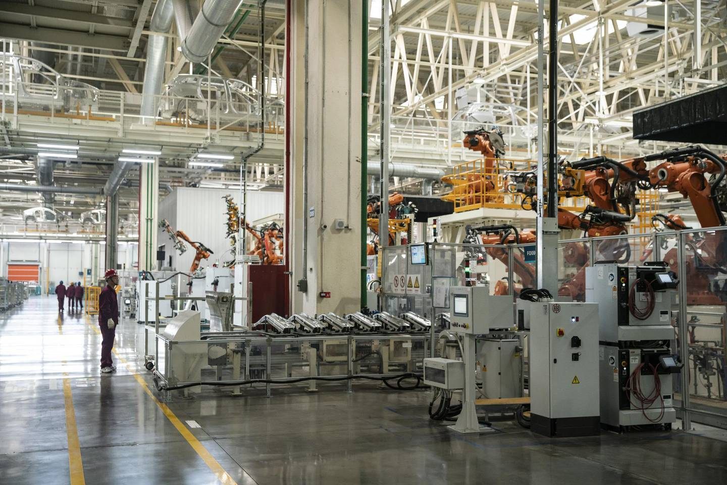 Robotic arms operate on a production line during a media tour of the Nio Inc. production facility in Hefei, Anhui province, China, on Friday, Dec. 4, 2020. Nio is cementing its role as a challenger to Tesla Inc. in China's premium electric-vehicle segment, with both companies benefiting as the coronavirus pandemic recedes in the country. Photographer: Qilai Shen/Bloomberg