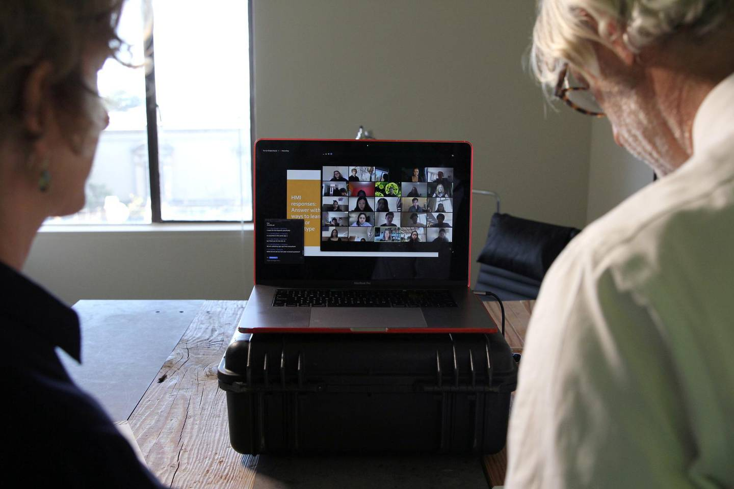University of California, Berkeley Professors Lisa Wymore (L) and Greg Niemeyer look at the Zoom screen showing students in their online Collaborative Innovation course in Berkeley, California, U.S., March 12, 2020. REUTERS/Nathan Frandino