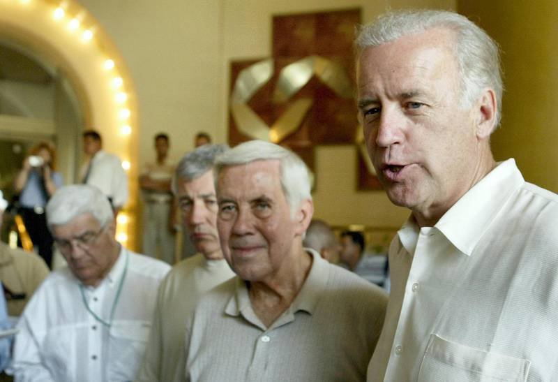 US Senator Richard Lugar of Indiana (C) and Chuck Hagel of Nebraska (2nd L) listen on as Joe Biden of Delaware (R) speaks to the press at a  hotel in Baghdad 23 June 2003. The congressional delegation is touring the capital and attending official meetings. AFP PHOTO/Marwan NAAMANI (Photo by MARWAN NAAMANI / AFP)