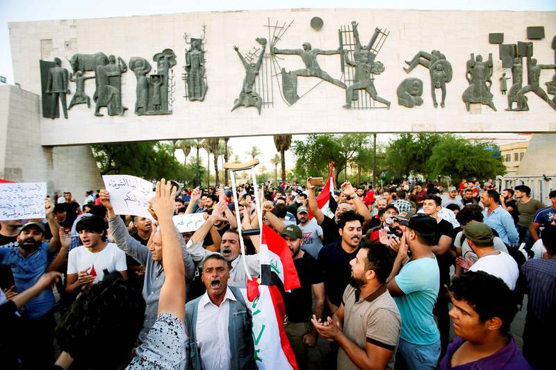 Iraqi shout slogans during a protest in Baghdad, Iraq July 16, 2018. REUTERS/Khalid Al-Mousily