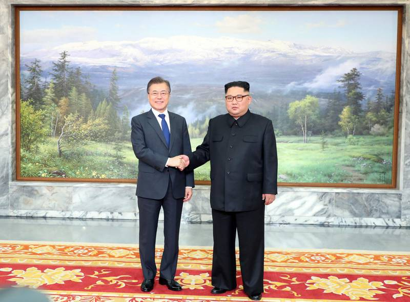 This picture taken on May 26, 2018 and released by the Blue House via Dong-A Ilbo shows South Korea's President Moon Jae-in (L) shaking hands with North Korea's leader Kim Jong Un before their second summit at the north side of the truce village of Panmunjom in the Demilitarized Zone (DMZ). South Korea said President Moon Jae-in met with North Korea's leader Kim Jong Un on May 26 inside the Demilitarised Zone dividing the two nations, a day after US President Donald Trump threatened to abandon a summit with Pyongyang. - South Korea OUT  / AFP / Dong-A Ilbo / Handout