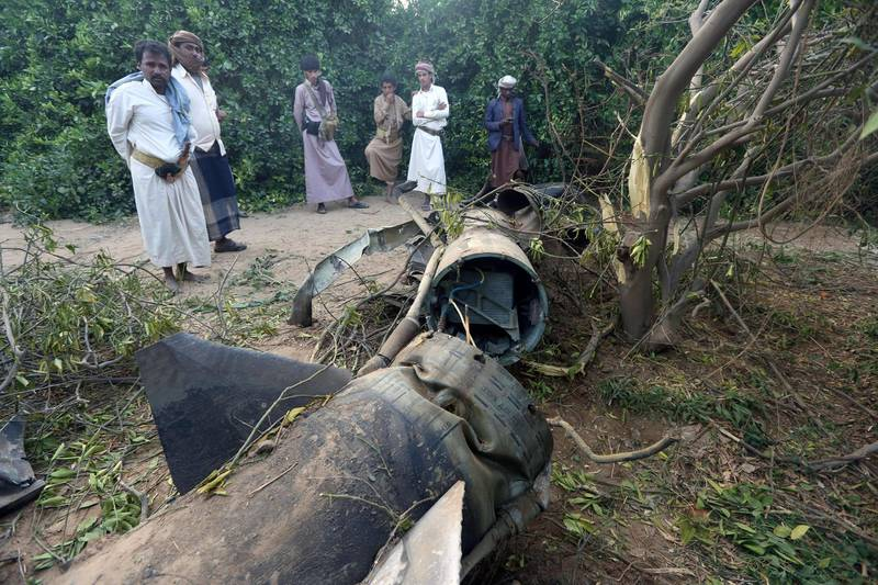 Tribesmen inspect fragments of a Houthi ballistic missile at a farm after it was intercepted by the Saudi-led coalition's air defence forces in Marib, Yemen February 23, 2018. Picture taken with a fisheye lens. REUTERS/Ali Owidha
