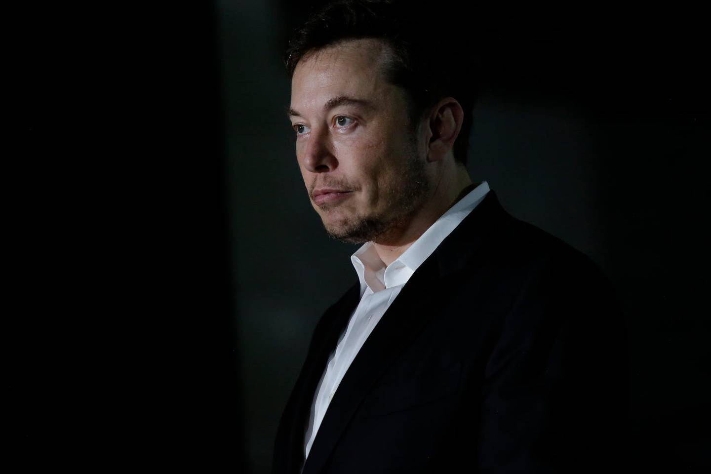 CHICAGO, IL - JUNE 14: Engineer and tech entrepreneur Elon Musk of The Boring Company listens as Chicago Mayor Rahm Emanuel talks about constructing a high speed transit tunnel at Block 37 during a news conference on June 14, 2018 in Chicago, Illinois. Musk said he could create a 16-passenger vehicle to operate on a high-speed rail system that could get travelers to and from downtown Chicago and O'hare International Airport under twenty minutes, at speeds of over 100 miles per hour. (Photo by Joshua Lott/Getty Images)