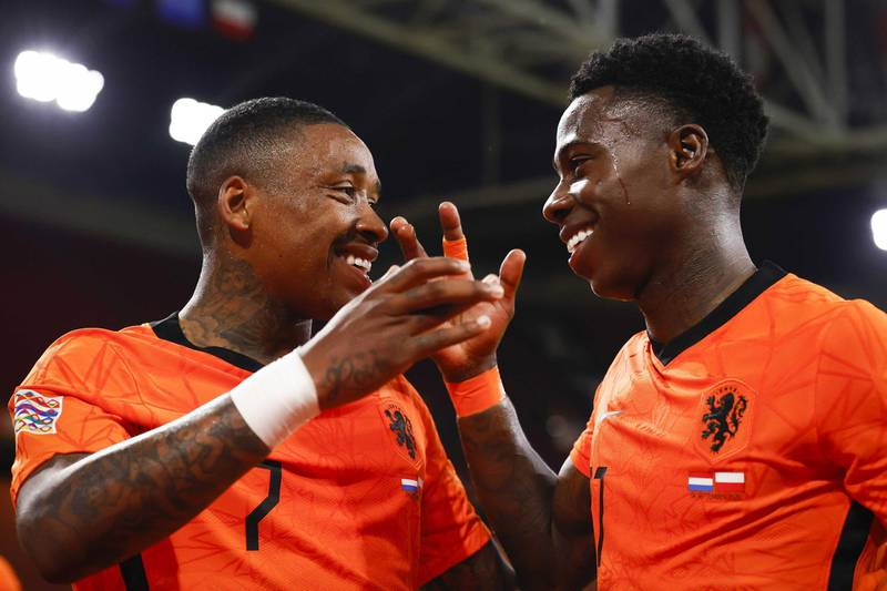 epa08647732 Steven Bergwijn (L) of the Netherlands celebrates with team-mate Quincy Promes after scoring the 1-0 goal during the UEFA Nations League A group 1 qualifying match between the Netherlands and Poland at the Johan Cruyff Arena in Amsterdam, The Netherlands, 04 September 2020.  EPA/KOEN VAN WEEL