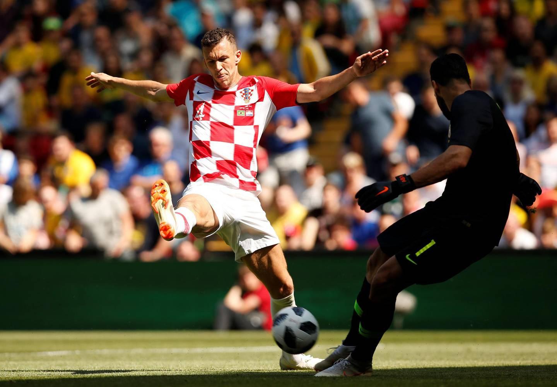 Soccer Football - International Friendly - Brazil vs Croatia - Anfield, Liverpool, Britain - June 3, 2018   Brazil's Alisson in action with Croatia's Ivan Perisic   REUTERS/Andrew Yates