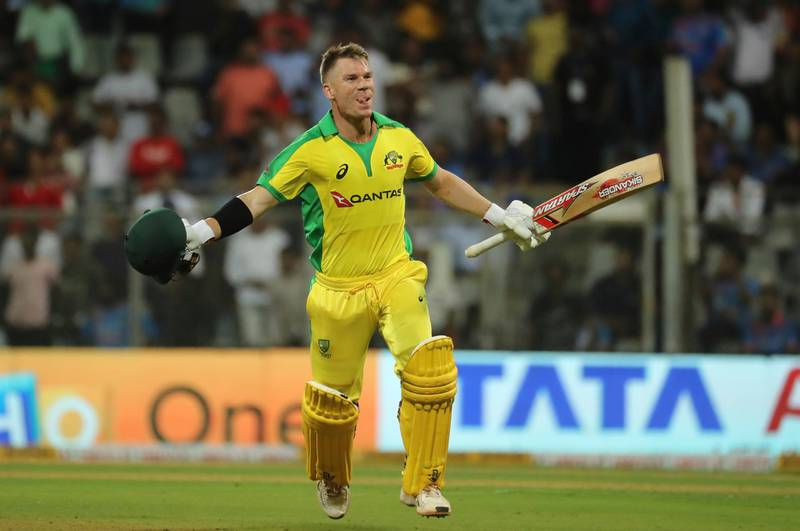 FILE - In this Tuesday, Jan. 14, 2020 file photo, Australia's David Warner celebrates after scoring a hundred during the first one-day international cricket match between India and Australia in Mumbai, India. David Warner, Steve Smith and Australia are back in South Africa for the first time since the ball-tampering drama of two years ago that led to 12-month bans for Warner and Smith, lost Smith the captaincy, and threw their team into turmoil. A three-match Twenty20 series gets underway on Friday, Feb. 20.  (AP Photo/Rafiq Maqbool, file)