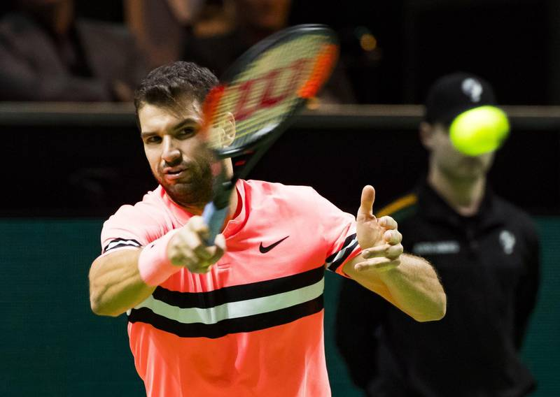 Grigor Dimitrov of Bulgaria plays a forehand return to Roger Federer of Switzerland during their men's singles final for the ABN AMRO World Tennis Tournament in Rotterdam on February 18, 2018.  / AFP PHOTO / ANP / Koen Suyk / Netherlands OUT