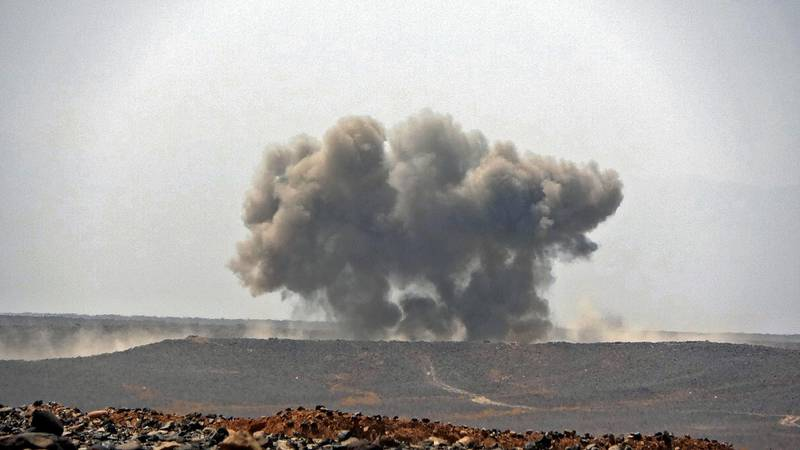 Smoke billows during clashes between forces loyal to Yemen's Saudi-backed government and Huthi rebel fighters in Yemen's northeastern province of Marib on March 5, 2021.  / AFP / -