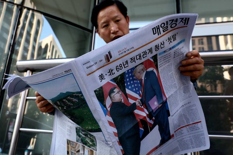 SEOUL, SOUTH KOREA - JUNE 12:  A South Korean man reads a newspaper reporting the U.S. President Trump meeting with North Korean leader Kim Jong-un on June 12, 2018 in Seoul, South Korea. U.S. President Trump and North Korean leader Kim Jong-un held the historic meeting between leaders of both countries on Tuesday morning in Singapore, carrying hopes to end decades of hostility and the threat of North Korea's nuclear programme.  (Photo by Chung Sung-Jun/Getty Images)