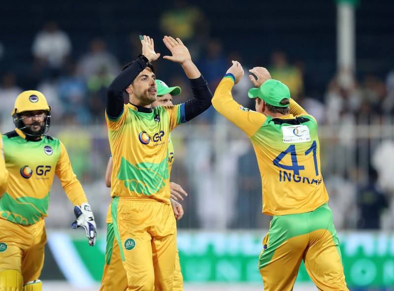 Sharjah, United Arab Emirates - December 02, 2018: Pakhtoons' Sharafuddin Ashraf takes the wicket of Warriors' Nicholas Pooran during the game between between Pakhtoons and Northern Warriors in the T10 final. Sunday the 2nd of December 2018 at Sharjah cricket stadium, Sharjah. Chris Whiteoak / The National