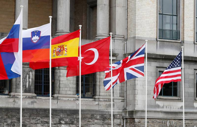 Flags are seen outside the Cinquantenaire, where NATO Heads of State and Government will gather for a working dinner as part of a NATO Summit in Brussels, Belgium July 10, 2018. REUTERS/Yves Herman
