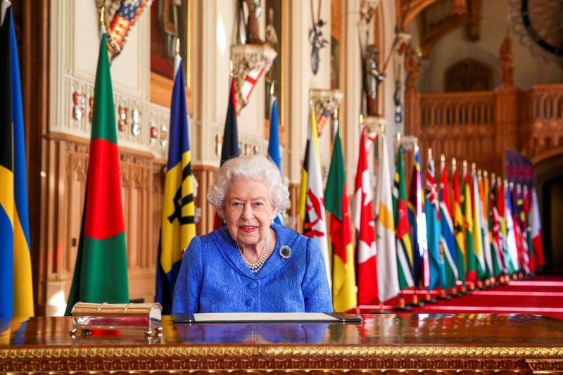 WINDSOR, UNITED KINGDOM:  In this undated image released on March 7, 2021, Queen Elizabeth II signs her annual Commonwealth Day Message in St George's Hall at Windsor Castle, to mark Commonwealth Day, in Windsor, England.  (Photo by Steve Parsons - WPA Pool/Getty Images)