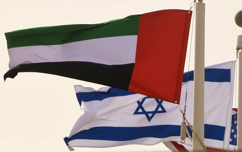 The Emirati, Israeli and US flags sway in the wind at the Abu Dhabi airport at the arrival  of the first-ever commercial flight from Israel to the UAE, on August 31, 2020. A US-Israeli delegation including White House advisor Jared Kushner took off on a historic first direct commercial flight from Tel Aviv to Abu Dhabi to mark the normalisation of ties between the Jewish state and the UAE. / AFP / KARIM SAHIB