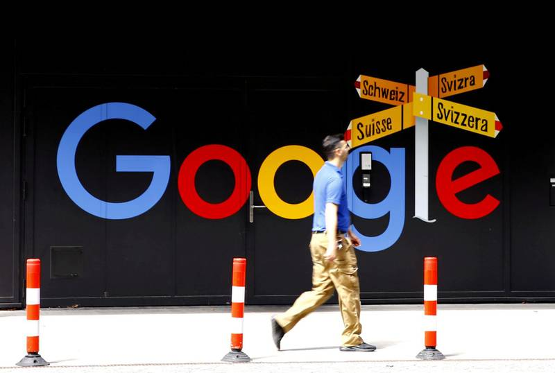 FILE PHOTO: A man walks past a logo of Google in front of at an office building in Zurich, Switzerland July 1, 2020.   REUTERS/Arnd Wiegmann/File Photo