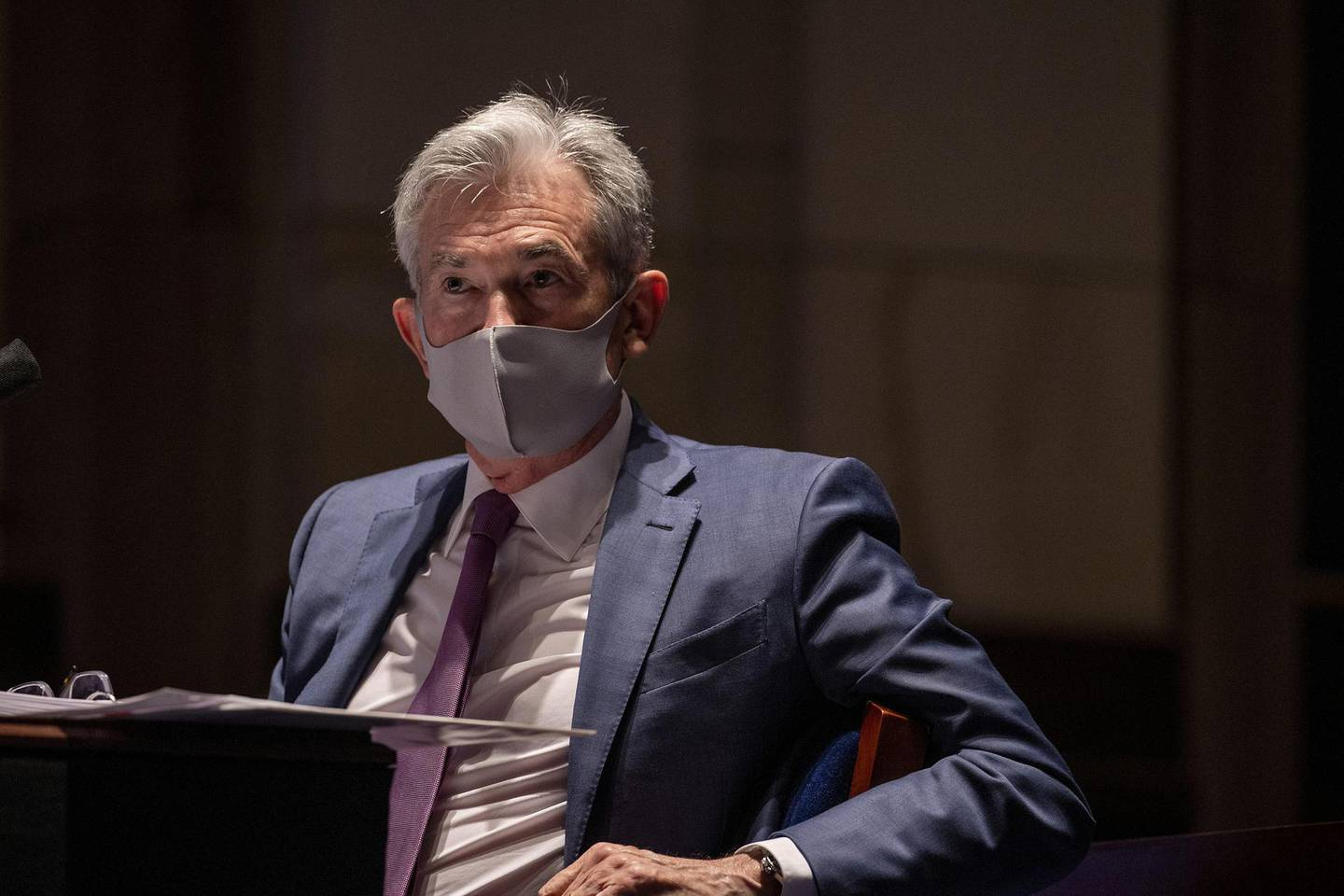 FILE PHOTO: Federal Reserve Chairman Jerome Powell, wearing a face mask, testifies before the House of Representatives Financial Services Committee during a hearing on oversight of the Treasury Department and Federal Reserve response to the outbreak of the coronavirus disease (COVID-19), on Capitol Hill in Washington, U.S., June 30, 2020. Tasos Katopodis/Pool via REUTERS/File Photo