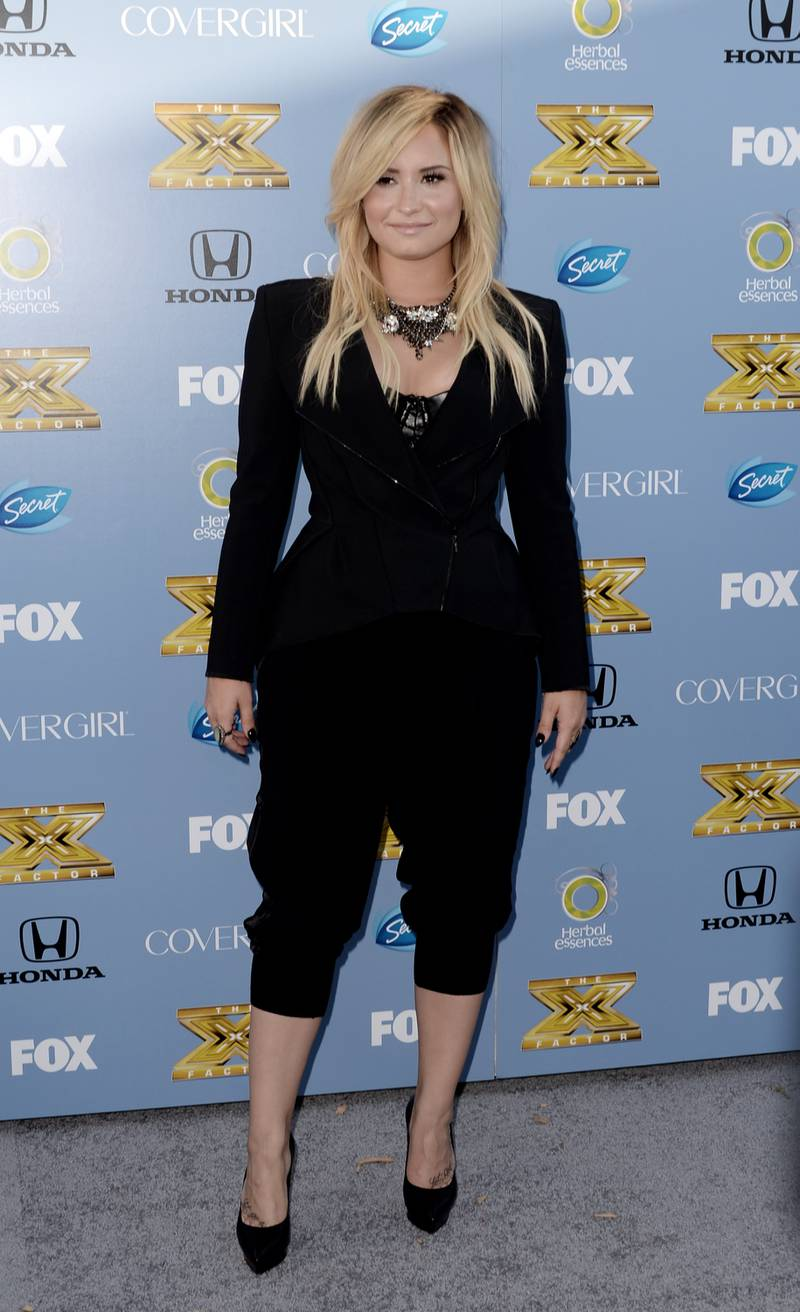 """WEST HOLLYWOOD, CA - SEPTEMBER 05: Singer Demi Lovato arrives at Fox's """"The X Factor"""" Season 3 premiere party at Ciccone Restaurant on September 5, 2013 in West Hollywood, California.   Kevin Winter/Getty Images/AFP"""
