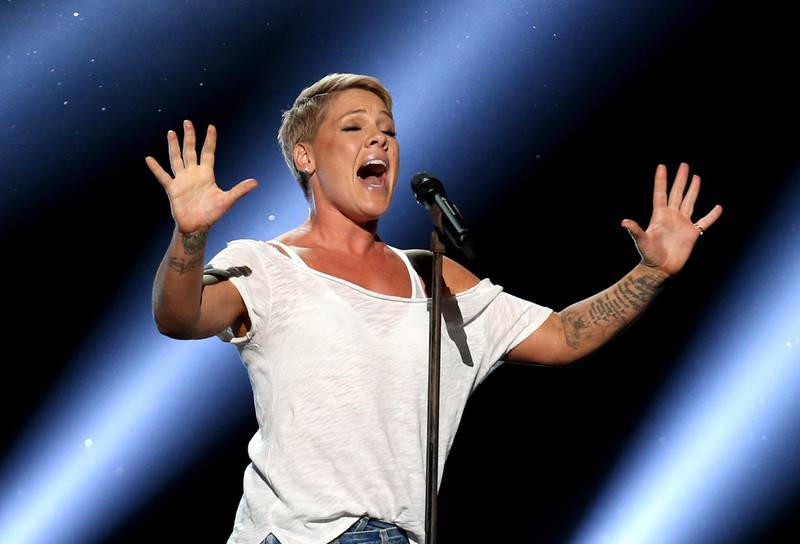 """FILE - In this Jan. 28, 2018, file photo, Pink performs """"Wild Hearts Can't Be Broken"""" at the 60th annual Grammy Awards at Madison Square Garden in New York. We are all learning a lot about each other these days and that's especially true with our celebrities. Social distancing has meant they have no army of publicists or glam squad. While many influencers and stars continue to post a flood of flattering, carefully stage-managed images, others are mirroring us — unshaven, unwashed and not ashamed. """"When I drink, I get really, really brilliant ideas,"""" the singer Pink confessed recently. """"And last night, I got an idea — I can cut hair. I can totally cut hair. Why have I been paying people all this time?"""" She then reveals some choppy, shaved spots on her head. (Photo by Matt Sayles/Invision/AP, File)"""