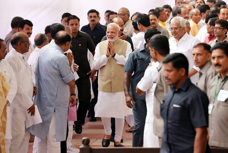 epa06092289 Prime Minister Narendra Modi  (C) greet Indian lawmakers as he leaves after casting his vote at Parliament House during the Indian presidential election in New Delhi, India, 17 July 2017. Lawmakers began voting to elect a new president with ruling Bharatiya Janata Party (BJP) candidate Ram Nath Kovind, who is widely seen as frontrunner for the largely ceremonial post.  EPA/HARISH TYAGI