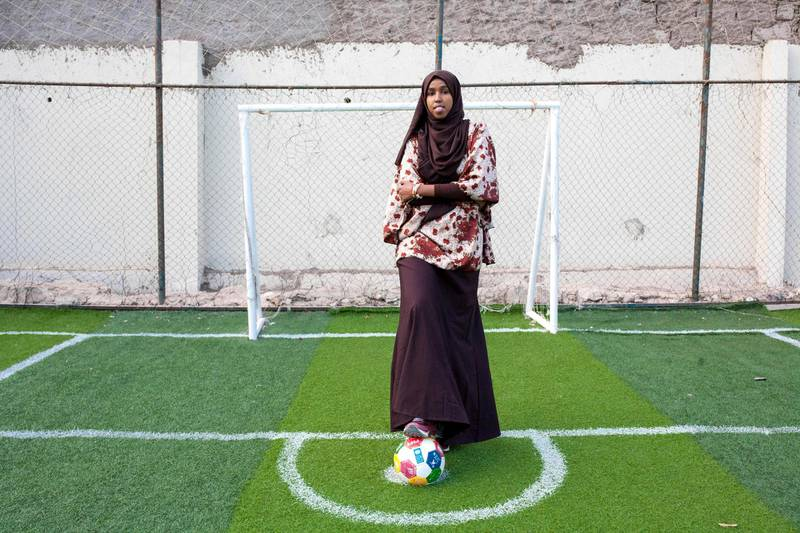 """To mark the occasion of International Women's Day on March 8, 2018 AFP presents a series of 45 photos depicting women performing roles or working in professions more traditionally held by men.  More images can be found in www.afpforum.com  Search SLUG  """"WOMEN-DAY -PACKAGE"""".  Somali football coach and player Marwa Mauled Abdi, 24, poses at the football ground of Ubah fitness center, the first football field exclusively opened for women, in Hargeisa, the capital of Somaliland, northwestern Somalia, on March 1, 2018. In the ring, battling flames or lifting off into space, women have entered professions generally considered as men's jobs. For International Women's Day, AFP met with women breaking down the barriers of gender-bias in the work world. / AFP PHOTO / Mustafa Saeed"""