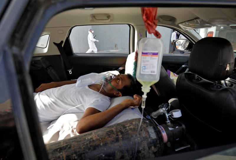 A patient with breathing problems is seen inside a car while waiting to enter a COVID-19 hospital for treatment, amidst the spread of the coronavirus disease (COVID-19), in Ahmedabad, India, April 22, 2021. REUTERS/Amit Dave