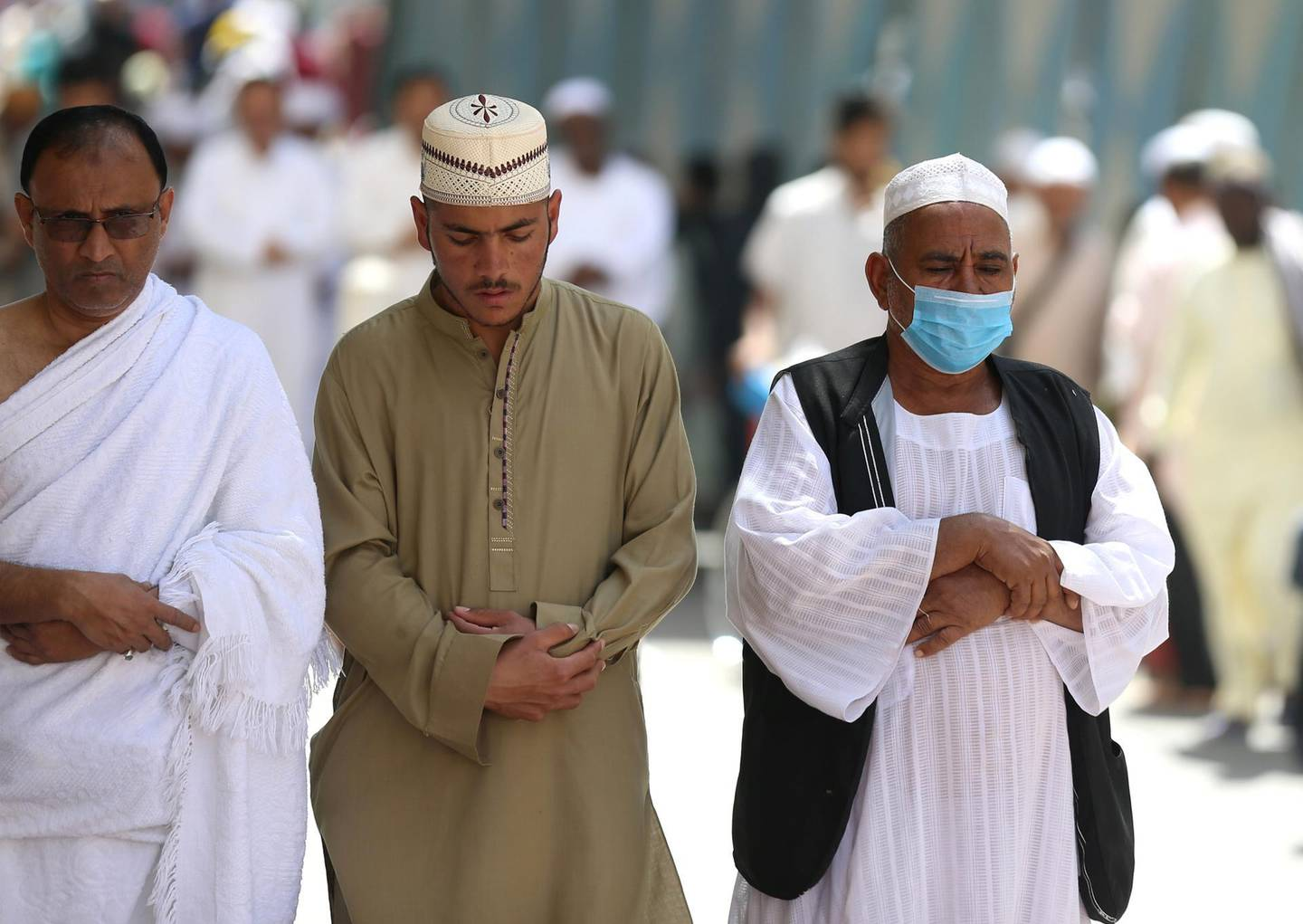 A muslim pilgrim wears a protective face mask to prevent contracting coronavirus, as he prays at the Grand mosque in the holy city of Mecca, Saudi Arabia February 27, 2020. REUTERS/Ganoo Essa