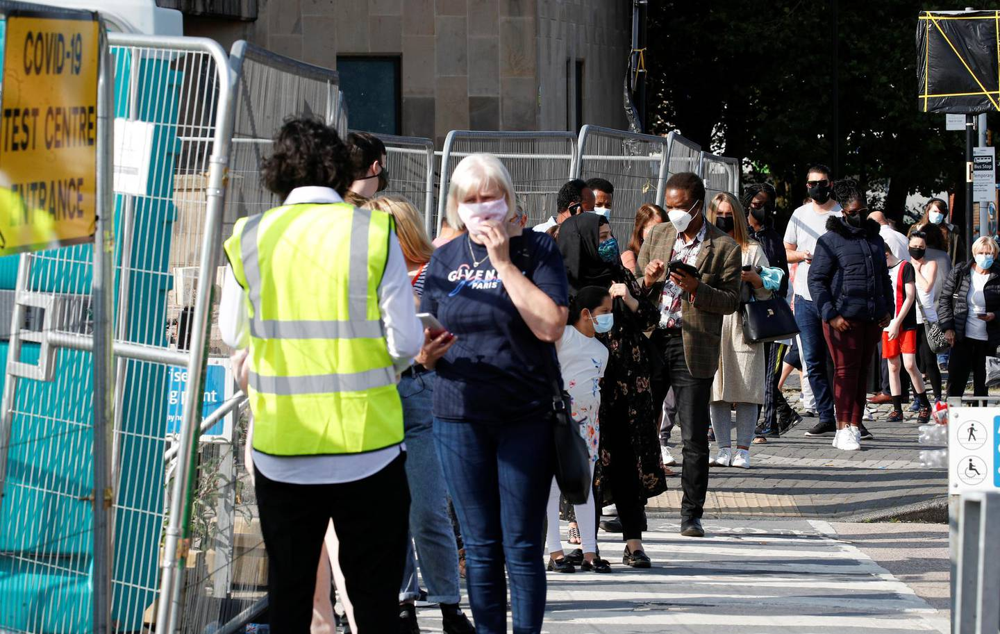 People queue outside a test centre to take a coronavirus test amid the coronavirus disease (COVID-19) outbreak, in Bolton, Britain, September 17, 2020. REUTERS/Phil Noble