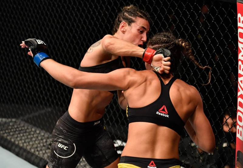 ABU DHABI, UNITED ARAB EMIRATES - JANUARY 23: In this handout image provided by the UFC, (L-R) Marina Rodriguez of Brazil punches Amanda Ribas of Brazil in a strawweight fight during the UFC 257 event inside Etihad Arena on UFC Fight Island on January 23, 2021 in Abu Dhabi, United Arab Emirates. (Photo by Jeff Bottari/Zuffa LLC via Getty Images)