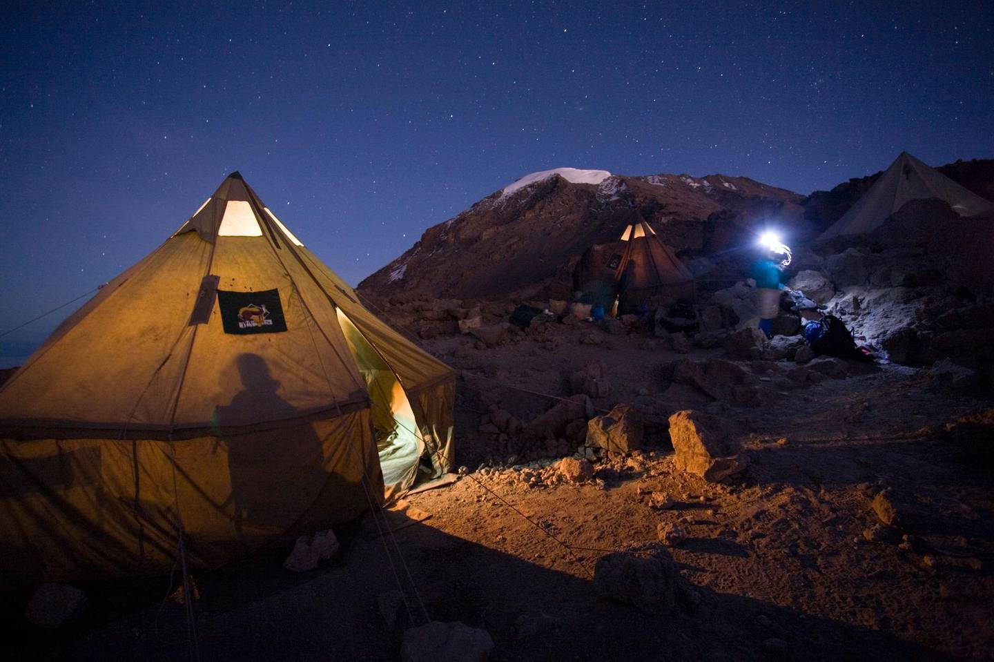 ADP5TW Africa Tanzania Kilimanjaro National Park Climbing partys tents glow before dawn summit departure from Barafu Camp. WorldFoto / Alamy Stock Photo