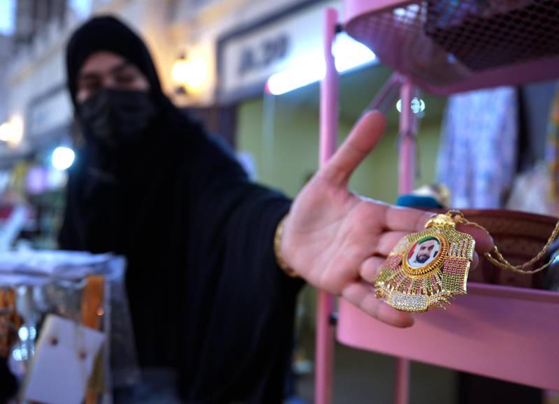 Abu Dhabi, United Arab Emirates, January 10, 2021.  Mariam Al Shehi displays a Sheikh Zayed medallion at the Middle Eastern market at Sheikh Zayed Festival.Victor Besa/The NationalSection:  NAReporter:  Saeed Saeed