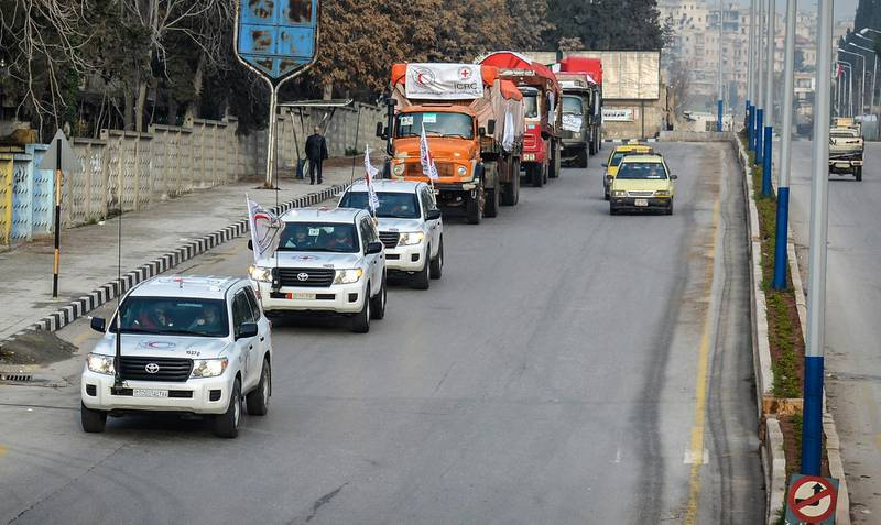 epa06572157 A handout photo made available by the Syrian Arab Red Crescent (SARC) shows a convoy of trucks carrying aid material heading to Afrin and Tall Riffat districts in the countryside of Aleppo, Syria, 01 March 2018. According to the official Syrian Arab NEWs Agency (SANA), a convoy of 28 trucks, carrying food and health materials and other relief goods, entered the crossing of al-Zyiara heading for Afrin area under the supervision of the Syrian Arab Red Crescent (SARC) and the International Committee of the Red Cross (ICRC). Turkey on 20 January 2018 launched its military operation into Afrin in a bid to clear the region of Kurdish YPG militias.  EPA/SARC HANDOUT  HANDOUT EDITORIAL USE ONLY/NO SALES