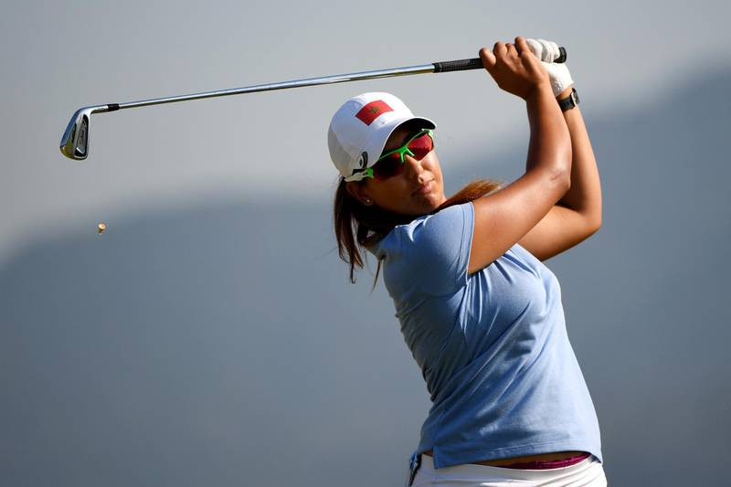 RIO DE JANEIRO, BRAZIL - AUGUST 17:  Maha Haddioui of Morocco plays her shot from the fourth tee during the First Round of Women's Golf on Day 12 of the Rio 2016 Olympic Games at Olympic Golf Course on August 17, 2016 in Rio de Janeiro, Brazil.  (Photo by Ross Kinnaird/Getty Images)
