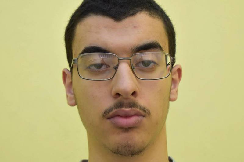 """A handout picture released by Great Manchester Police March 17, 2020 shows Hashem Abedi, the Manchester-born man who was found guilty of 22 counts of murder, attempted murder and conspiracy to cause explosions, over the 2017 Manchester Arena suicide bomb attack carried outt by his brother Salman Abedi. Hashem Abedi, the brother of a suicide bomber who killed 22 people at an Ariana Grande concert in Manchester in 2017 on August 19, 2020 refused to attend his sentencing hearing for murder. A jury found Hashem Abedi, 23, guilty of 22 counts of murder, attempted murder and conspiring to cause explosions at the gig in northwest England after a trial that ended in March. The attack, carried out by IS-inspired jihadi Salman Abedi, 22, was one of the deadliest terror attacks ever carried out in Britain, and left more than 200 people injured. - RESTRICTED TO EDITORIAL USE - MANDATORY CREDIT """"AFP PHOTO / GREATER MANCHESTER POLICE """" - NO MARKETING - NO ADVERTISING CAMPAIGNS - DISTRIBUTED AS A SERVICE TO CLIENTS  / AFP / GREATER MANCHESTER POLICE / - / RESTRICTED TO EDITORIAL USE - MANDATORY CREDIT """"AFP PHOTO / GREATER MANCHESTER POLICE """" - NO MARKETING - NO ADVERTISING CAMPAIGNS - DISTRIBUTED AS A SERVICE TO CLIENTS"""
