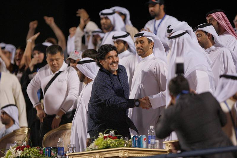 Dubai, United Arab emirates, Nov 3 2012, Beach Soccer Championship, UAE v Nigeria-  Diego Maradona  is greeted in the stans by VIP's and invited guests . Mike Young / Yhe National