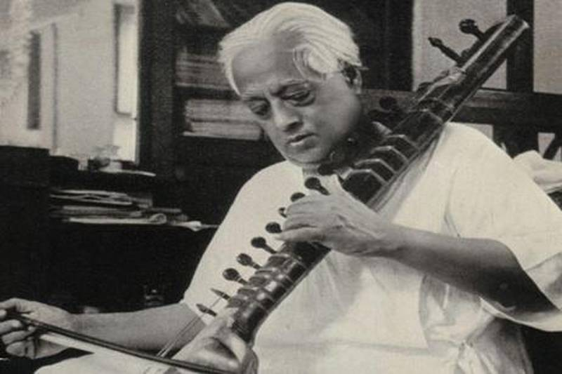 """S.N. Bose playing the Esraj - Bose was an accomplished Esraj player. He is credited for composing original ragas.Mandatory Credit: Courtesy of Falguni Sarkar. Bose Family. Used with permission. www.snbose.org"""""""