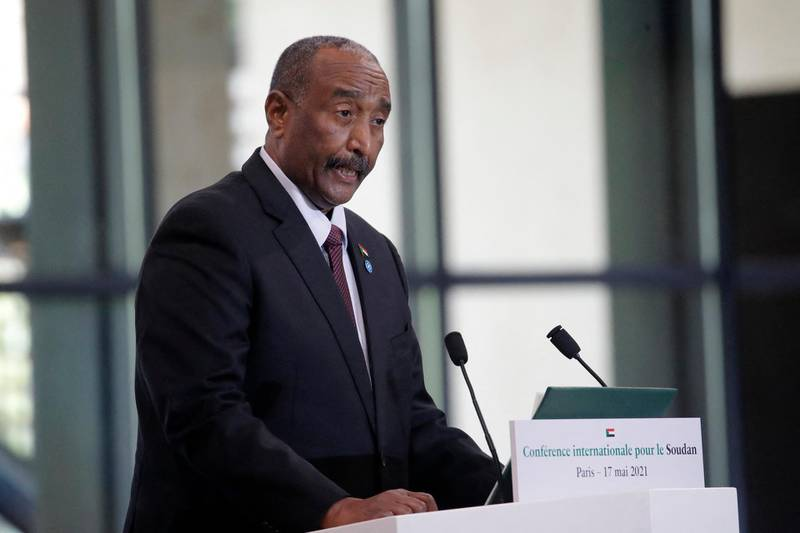 Sudan's President Abdel Fattah Al-Burhan speaks during a session of the international conference on Sudan which aims to provide financing breathing room for its Prime Minister as he pursues economic reforms in Paris on May 17, 2021. - The French government promised to lend $1.5 billion to Sudan to help it pay off its massive foreign debt, kicking off an international summit aimed at helping the aspiring democracy emerge from decades of authoritarian rule. (Photo by Christophe Ena / POOL / AFP)