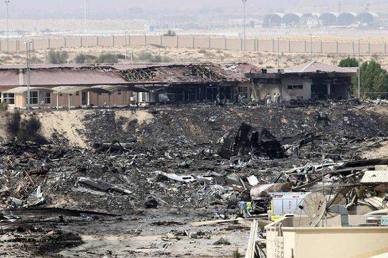 epa02315968 A general view of the site where a cargo airplane crashed while taking off from Dubai airport, United Arab Emirates, on 04 September 2010. A United Parcel Services (UPS) cargo plane crashed near Dubai airport on 03 September 2010 as it was taking off for Germany. Officials in the Emirate said two people died in the incident.  EPA/ALI HAIDER