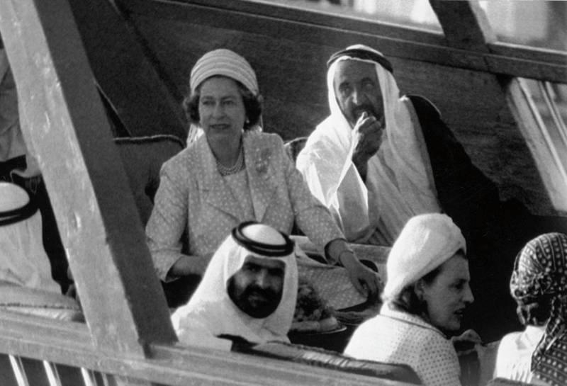 Britain's Queen Elizabeth II sits beside Sheikh Rashid Bun Saeed Al Maktoum, the ruler of Dubai, right, on the Sheikh's  new dhow, as they are taken on a sightseeing tour of Dubai, on Feb. 26, 1979. (AP Photo/Kemp)