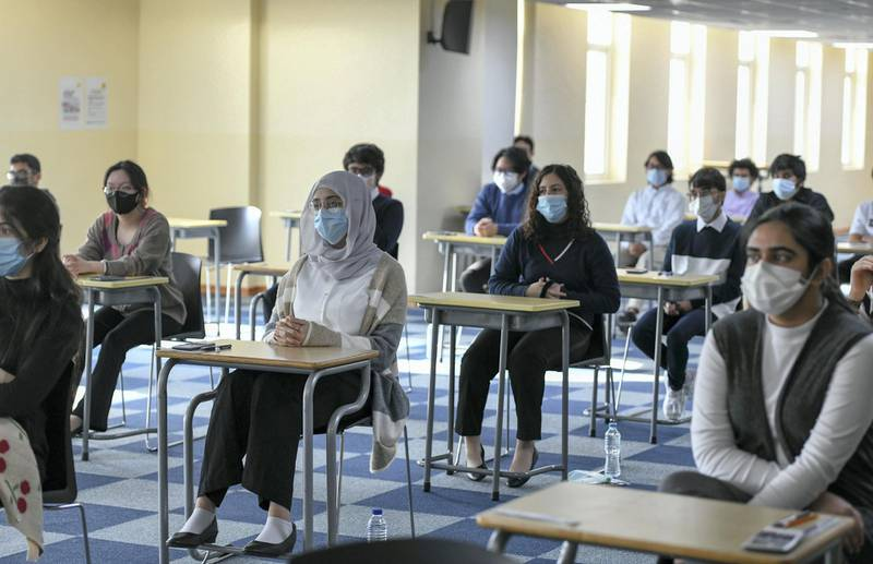 Abu Dhabi, United Arab Emirates - Pupils seated for the Biology, grade 12 exam following social distancing guidelines at Gems Cambridge International School in Baniyas. Khushnum Bhandari for The National