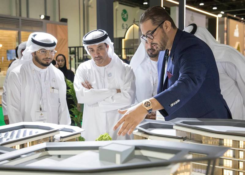 ABU DHABI, UNITED ARAB EMIRATES - April 16, 2019: HH Sheikh Hazza bin Zayed Al Nahyan, Vice Chairman of the Abu Dhabi Executive Council (2nd L), attends the opening of Cityscape Abu Dhabi, at Abu Dhabi National Exhibition Centre (ADNEC).   ( Mohammed Al Blooshi for Ministry of Presidential Affairs ) ---