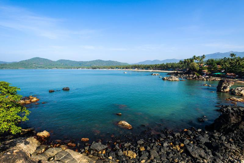 PALOLEM, GOA, INDIA - 2013/12/14: Palolem Beach with blue sky, palm trees, white sand and blue sea is one of the famous beaches in the former Portuguese colony Goa. (Photo by Frank Bienewald/LightRocket via Getty Images)
