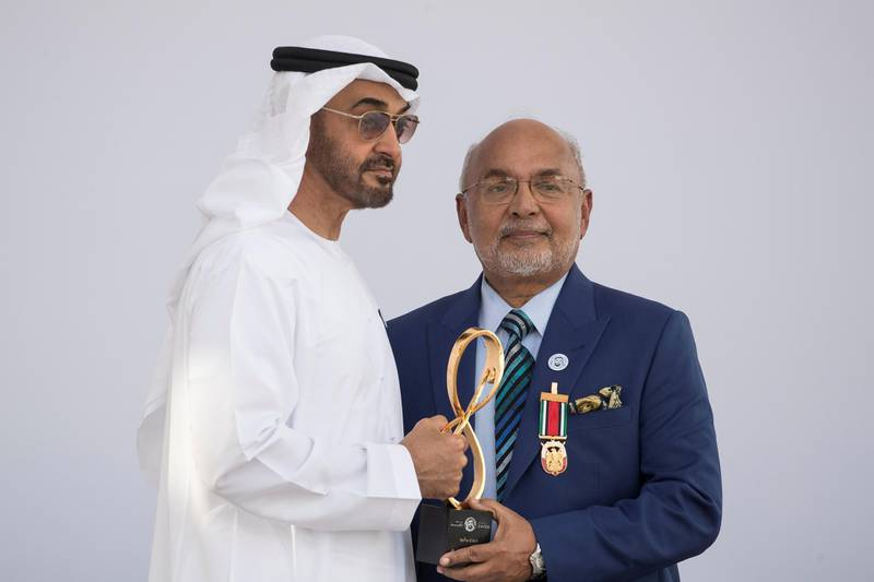 ABU DHABI, UNITED ARAB EMIRATES -  March 12, 2018: HH Sheikh Mohamed bin Zayed Al Nahyan, Crown Prince of Abu Dhabi and Deputy Supreme Commander of the UAE Armed Forces (L), presents an Abu Dhabi Award to George Mathew (R), during the awards ceremony at the Sea Palace. ( Ryan Carter for the Crown Prince Court - Abu Dhabi ) ---