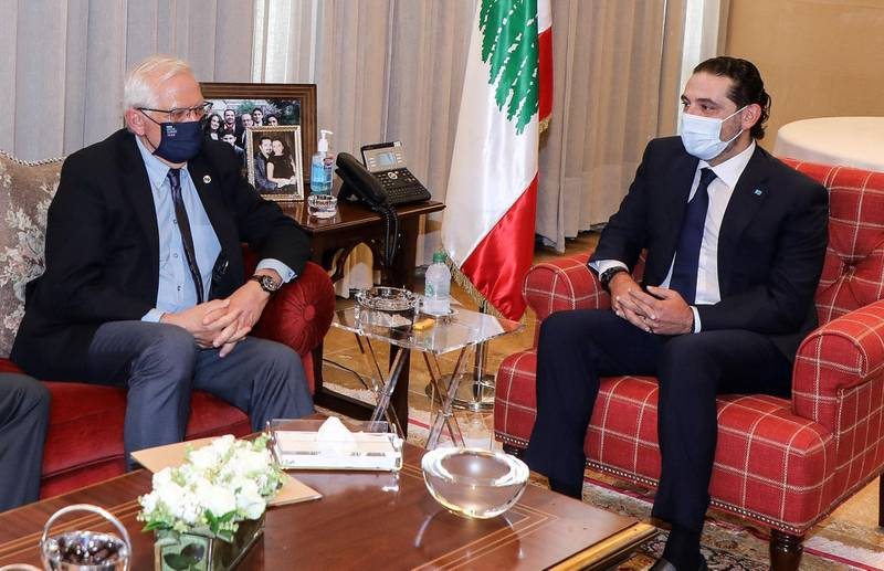 """A handout picture provided by the Lebanese photo agency Dalati and Nohra shows Lebanese Prime Minister Saad Hariri (R) meeting with the  European Union High Representative for Foreign Affairs and Security Policy Josep Borell, ain the capital Beirut, on June 19, 2021. Borrell warned Lebanese leaders could face sanctions unless they pull the country away from financial collapse and strike a deal with the IMF. Lebanon is facing what the World Bank has described as one of the world's worst economic crises since the 1850s and a political crisis has left the country without a functioning government since the last once resigned after a massive bomb blast in August that killed dozens and destroyed swathes of the capital Beirut.   - === RESTRICTED TO EDITORIAL USE - MANDATORY CREDIT """"AFP PHOTO / HO / DALATI AND NOHRA"""" - NO MARKETING - NO ADVERTISING CAMPAIGNS - DISTRIBUTED AS A SERVICE TO CLIENTS ===  / AFP / DALATI AND NOHRA / - / === RESTRICTED TO EDITORIAL USE - MANDATORY CREDIT """"AFP PHOTO / HO / DALATI AND NOHRA"""" - NO MARKETING - NO ADVERTISING CAMPAIGNS - DISTRIBUTED AS A SERVICE TO CLIENTS ==="""