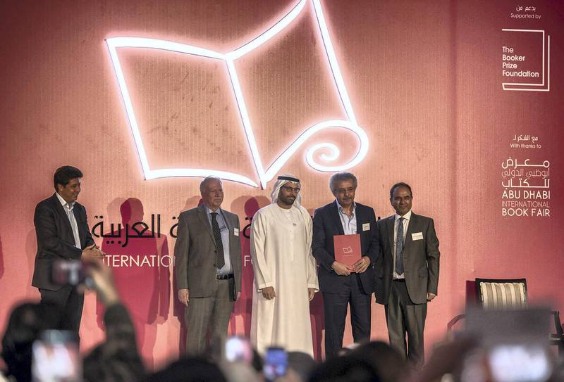 """4 April 2018:From to left to right Ibrahim Al Saafin , HE Mohamed Khalifa Al Mubarak, Winner  Ibrahim Nasrallah for the """"The Second War of the Dog""""  Professor Yasir Suleiman of International Prize for Arabic Fiction which held at Abu Dhabi, UAE ,vidhyaa for The Nationa"""
