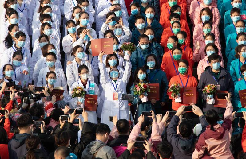 epa08285089 Medical staff celebrate after all patients were discharged at Wuchang Fangcang hospital, a temporary hospital set up at Hongshan gymnasium to treat people infected with the coronavirus and COVID-19 disease, in Wuhan, Hubei Province, China, 10 March 2020 (issued 11 March 2020). The temporary hospital closes on 10 March after China reported days of decline in the number of new coronavirus cases originating in the country. However, the number of coronavirus cases imported to China continued to rise, with 40 percent of the latest 24 infections reported on 11 March stemming from overseas.  EPA/YFC CHINA OUT