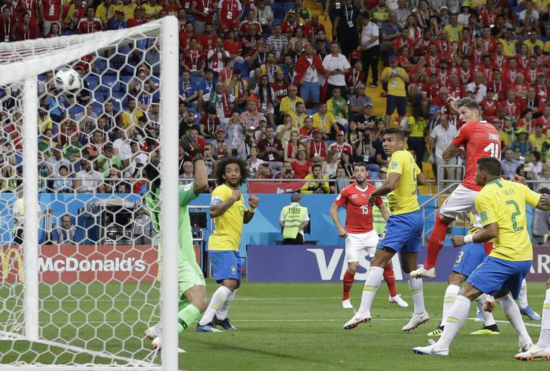 Switzerland's Steven Zuber, second from right, scores his side's opening goal during the group E match between Brazil and Switzerland at the 2018 soccer World Cup in the Rostov Arena in Rostov-on-Don, Russia, Sunday, June 17, 2018. (AP Photo/Themba Hadebe)